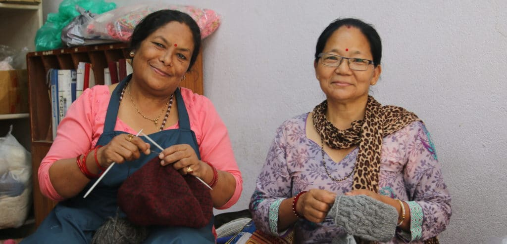 Two Women Handknitting with smile