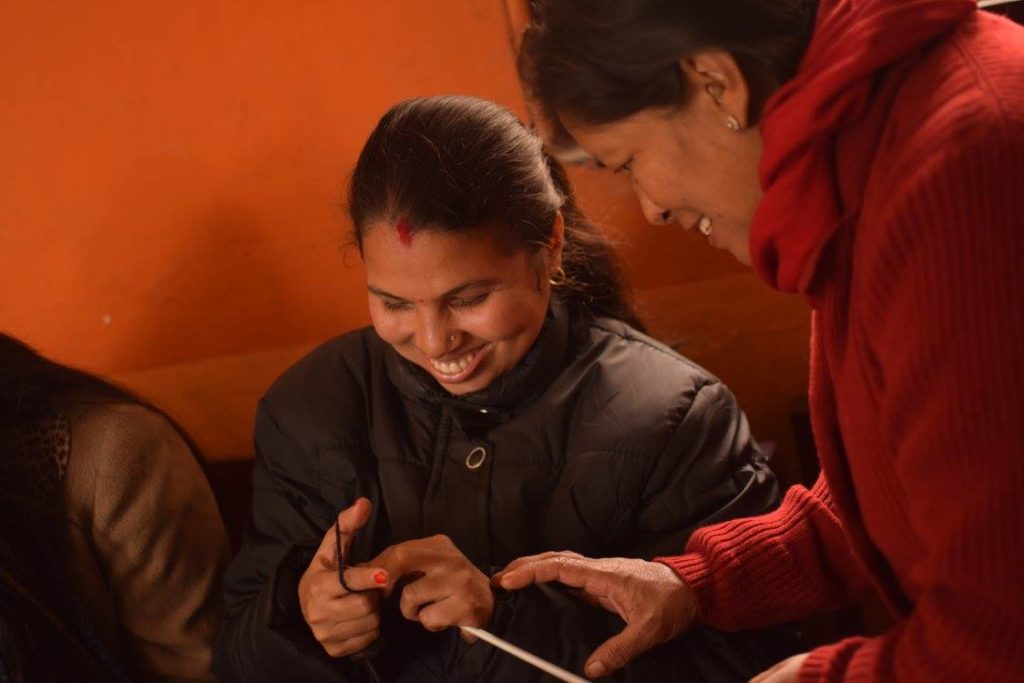 Providing training to Blind people at Sparsha Project